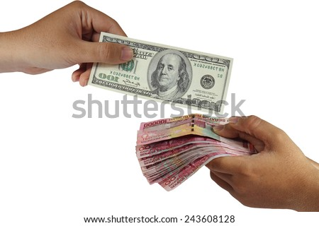 Hands doing money exchange of Dollar and Rupiah isolated on white - stock photo