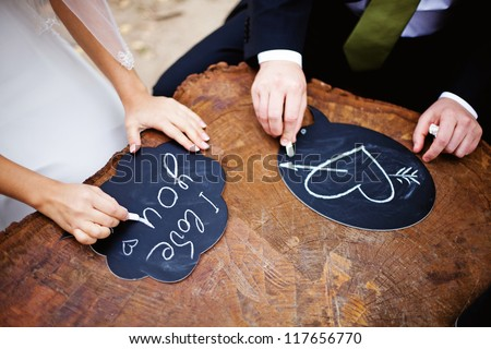 Hands drawing love - stock photo