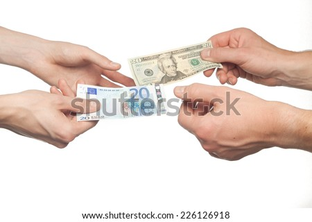 hands exchanging euros and dollars money isolated on white background, money exchange concept - stock photo