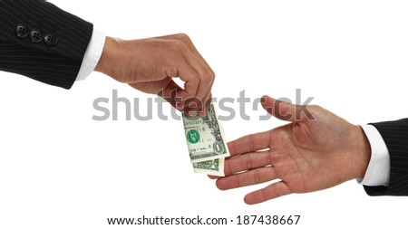 Hands exchanging money or giving money to another close up,