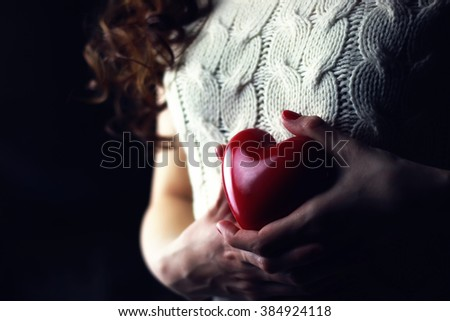 Hands female heart breast love