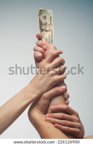 hands fighting for money  - stock photo