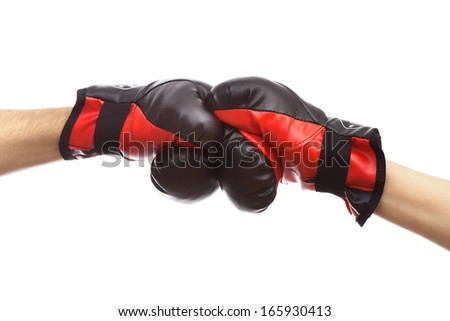 Hands fighting in boxing gloves  on white background