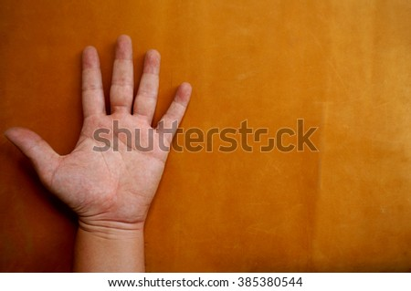 hands five fingers on the leather background selective focus - stock photo