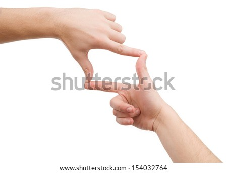 Hands focusing. Close-up of hands gesturing while isolated on white