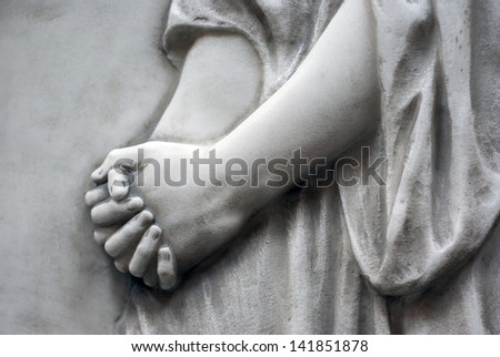 hands folded - stock photo