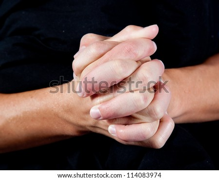 Hands folded as if in prayer or showing closeness and connection as in teamwork