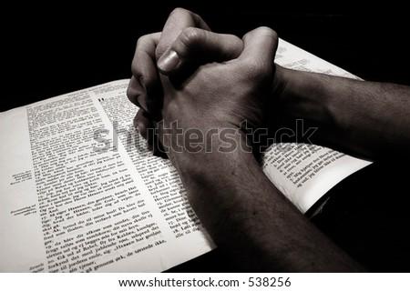 Hands folded in desperate prayer - stock photo