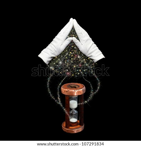 Hands folded in the form of roof above hourglass - stock photo