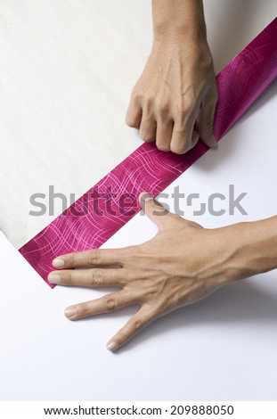 Hands Folding paper for wrapping present - stock photo