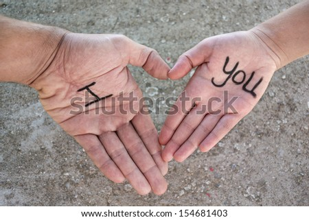 Hands forming a heart and the word I Love You
