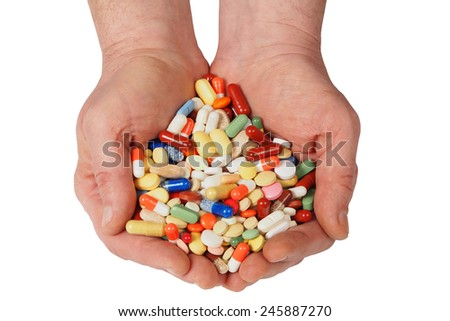 Hands full of medicine isolated on white background - stock photo