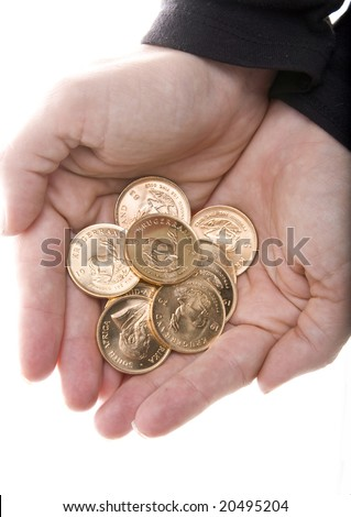 Hands full of one Ounce gold Krugerrand coins from South Africa isolated on white. - stock photo