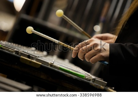 Hands girl playing a glockenspiel - stock photo