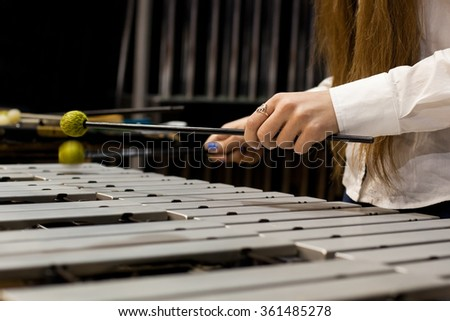 Hands girl playing the vibraphone - stock photo