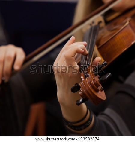 Hands girl playing the violin closeup - stock photo
