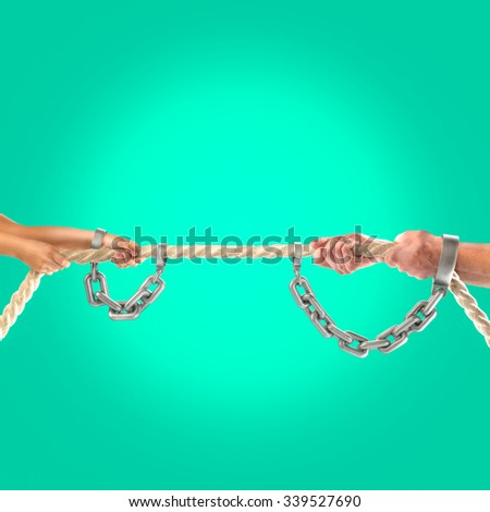 Hands girls and adult men pulling the rope in iron chains . Cooperation concept - stock photo