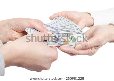 Hands giving money to other hands isolated on white. - stock photo