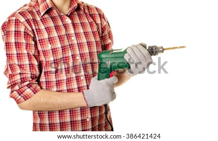 hands handling an electric drilling machine - stock photo