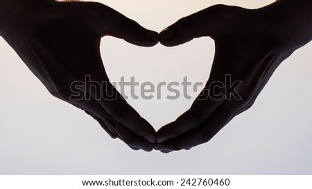 hands heart silhouette love  on sky background - stock photo