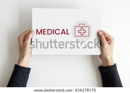 Hands hold a card with healthcare concept word