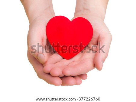 hands hold a red heart on the white background