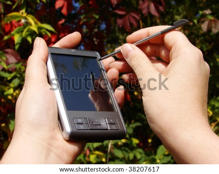 hands hold and pointing  pocket computer