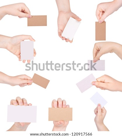 Hands hold business cards on white background