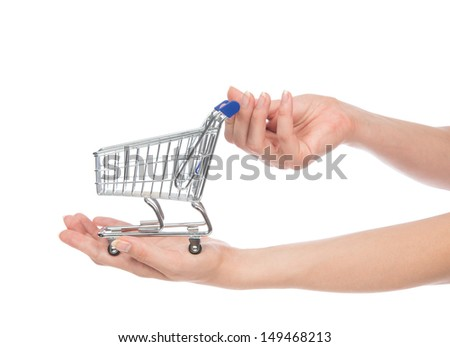 Hands hold empty shopping cart for sale isolated on a white background
