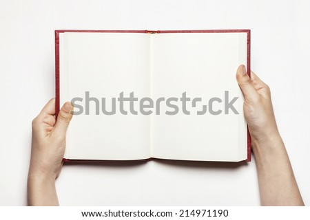hands hold the red book(diary) empty spread isolated white. - stock photo