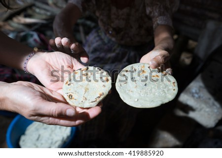 hands hold up tortillas in guatemala  - stock photo