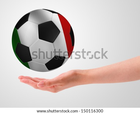 Hands holding a ball with flag of italy - stock photo