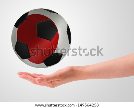 Hands holding a ball with flag of japan - stock photo