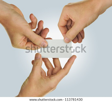 Hands holding a blank business card representing teamwork