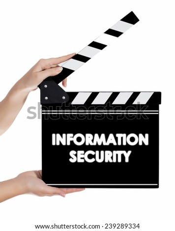 Hands holding a clapper board with INFORMATION SECURITY text - stock photo
