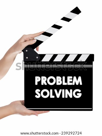 Hands holding a clapper board with PROBLEM SOLVING text - stock photo