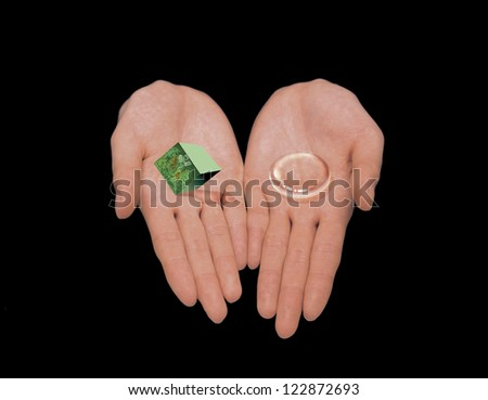 Hands holding a cube with nature scene and water