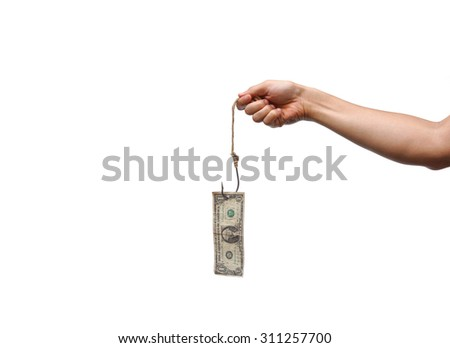 hands holding a dollar banknote hung on a fish hook - money trap concept - stock photo