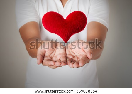 hands holding a  heart shape, valentine background