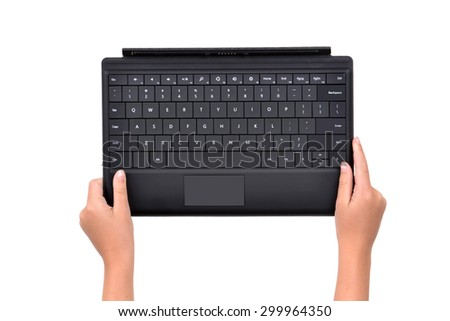 hands holding a keypad isolated white background - stock photo