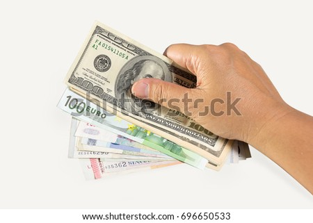 Hands holding a lot of money.dollar money,Euro money,singapor money,Business concept