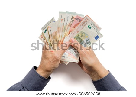 Hands holding a lot of money. Isolated on white background