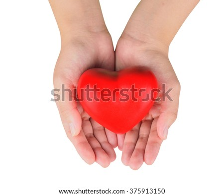 Hands holding a red heart as symbol for love and care