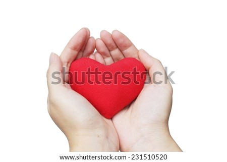 hands holding a red heart - giving and sharing love concept