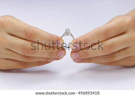 Hands holding a ring on a white background
