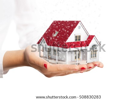 Hands holding a small house isolated on white