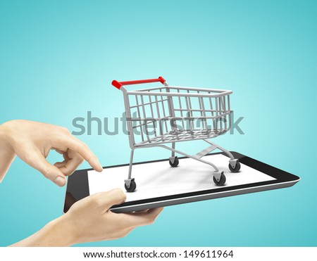 hands holding a  touch pad with cart