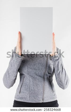 Hands holding a white paper blank isolated on white background.