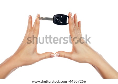 Hands holding an automobile key isolated on white