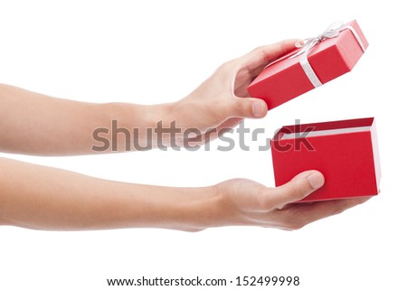 Hands holding an opened gift box